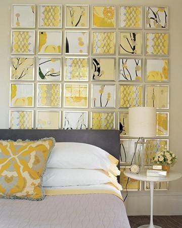 Keltaiset taulut sängynpäätynä